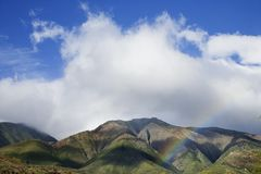 Maui mountains with rainbow. Stock Photos