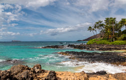 Maui ocean view. Beautiful tropical ocean view from a remote beach on Maui with Molokini island in the background Stock Photography