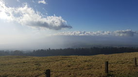 Maui pastures. Misty view of beautiful hawaiian island from the drive up to Haleakala Royalty Free Stock Photos