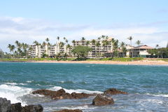 Maui Resort Vacation Spot. Maui Beach scene with people taking pictures Stock Photo