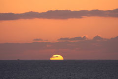 Maui Sunset. The sun setting into the Pacific ocean in Maui royalty free stock photo