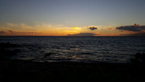 Maui sunset. Sun setting over the Pacific Ocean Stock Image