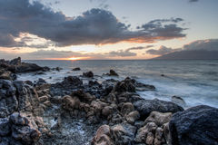 Maui Tidal Pool Sunset. Sunset on Maui looking across to the next island over tidal pools and rocks Royalty Free Stock Photography