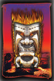 Maui Tiki. Image of real hand carved Tiki taken into Photoshop and added flames and fire Royalty Free Stock Photography