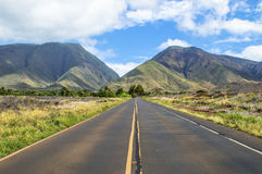 Maui. V-shape Maui mountains view from the middle of the road stock photography
