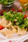 Maultaschen - swabian filled pasta  ravioli . Maultaschen - swabian filled pasta ravioli on white dish stock photos