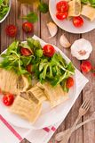 Maultaschen - swabian filled pasta  ravioli . Maultaschen - swabian filled pasta ravioli on white dish royalty free stock photo