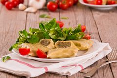 Maultaschen - swabian filled pasta  ravioli . Maultaschen - swabian filled pasta ravioli on white dish stock images