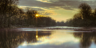 Maumee River Morning. A view looking downstream on the Maumee River just after sunrise royalty free stock image