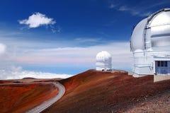 Mauna Kea Observatories on top of Mauna Kea mountain peak, Hawaii, USA. Observatories on top of Mauna Kea mountain peak. Astronomical research facilities and Stock Photos