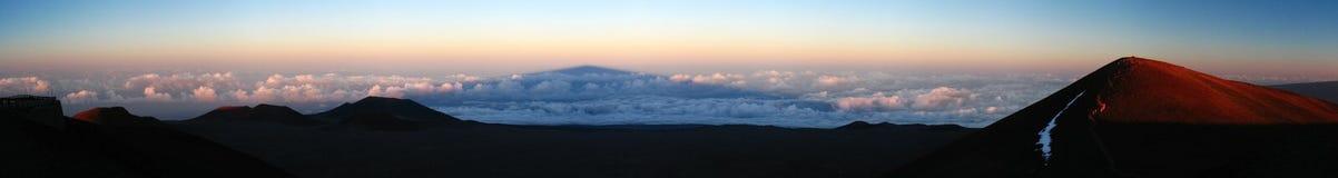 Mauna Kea Shadow. Shadow of Mauna Kea on cloud cover at dusk seen from summit Royalty Free Stock Photo