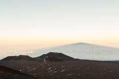Mauna Kea shadow on cloud layer. Royalty Free Stock Photography