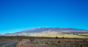 Mauna Kea and Snow capped Peaks Royalty Free Stock Photo
