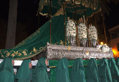 Maundy Thursday procession in Nerja Spain. The Easter processions start on Maunday Thursday and finish on Easter Sunday. The statue from the Church of El Royalty Free Stock Photo