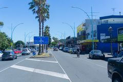 Maunganui Road with information sign directing to shopping area, Pilot Bay and Main Beach. MOUNT MAUNGANUI NEW ZEALAND - FEBRUARY 8 2019: Maunganui Road with stock photos