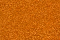 Maurerarbeitwände orange. Stockbilder
