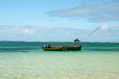 Maurician men by fishing Stock Images