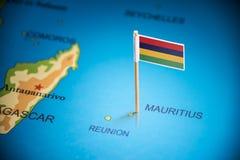 Mauricio marcó con una bandera en el mapa imagen de archivo libre de regalías