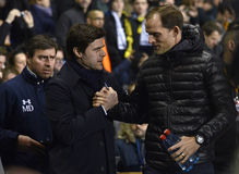 Mauricio Pochettino and Thomas Tuchel. The managers of the teams pictured prior to the UEFA Europa League round of 16 game between Tottenham Hotspur and Borussia royalty free stock images