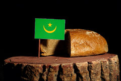 Mauritania flag on a stump with bread. Isolated stock image