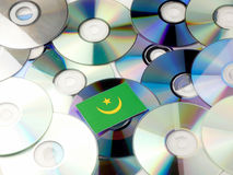 Mauritania flag on top of CD and DVD pile isolated on white. Mauritania flag on top of CD and DVD pile isolated Royalty Free Stock Image