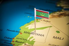Mauritania marked with a flag on the map.  stock images