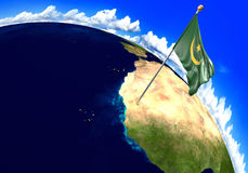 Mauritania national flag marking the country location on world map. 3D render of the national flag of Mauritania over the geographic location of the country on a Stock Photography