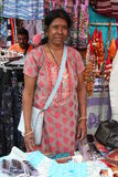 Mauritian Woman - Market Scene. Portrait: Smiling woman in Indian saree dress selling clothes on a street market on the isle of Mauritius.The country is known Stock Photos