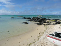 Mauritius. Panorama of Mauritius, precisely the Cap Malheureux (in the north of the island). Landscape with a peace of fine sand beach, black rocks plunging in Stock Photo