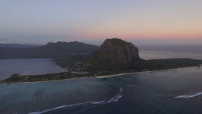 Mauritius aerial view with Le Morne Brabant mountain and ocean stock footage