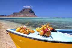 MAURITIUS: A boat with coconuts on Benitiers Island with the Morne Braband in the background Stock Photography