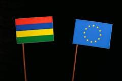 Mauritius flag with European Union EU flag isolated on black Stock Images