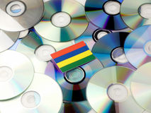 Mauritius flag on top of CD and DVD pile isolated on white. Mauritius flag on top of CD and DVD pile isolated Royalty Free Stock Photos