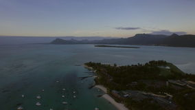 Mauritius Island aerial scene with ocean, coast and mountain ranges. Aerial evening shot of the coast on Le Morne Brabant peninsula and distant view of mountain stock footage