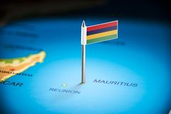Mauritius marked with a flag on the map.  stock photo