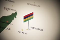 Mauritius marked with a flag on the map.  royalty free stock image