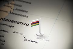 Mauritius marked with a flag on the map.  royalty free stock images