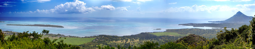 Mauritius. View Of Mountains And Indian Ocean In A Sunny Day, Panorama Royalty Free Stock Photos