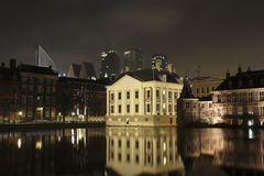 Mauritshuis at the hofvijver. In the Hague right in the picture you see the binnenhof where politics of Netherlands is working royalty free stock image