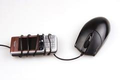 Maus und Handy Stockbild