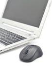 Maus und Laptop Stockfoto