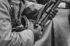Mauser rifle in the hands of a German soldier. World War II. Mauser rifle in the hands of the Wehrmacht soldier World War II, the bolt is cocked. Black and white royalty free stock photography