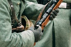 Mauser rifle in the hands of the German soldier stock photos