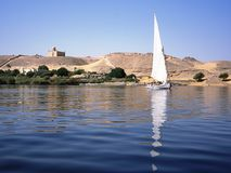 Mausoleum of the Aga Khan in Egypt and felucca on the Nile. Stock Image