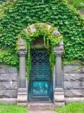 Mausoleum Door. View of old mausoleum door with ivy vines stock photography