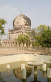 Mausoleum and fountain, Hyderabad. View from an Islamic pond and fountain looking towards the tomb of Muhammed Qutub Shah, the sixth Sultan.  Part of a complex Royalty Free Stock Images