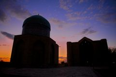 Mausoleum of Khoja Ahmed Yasavi at sunset in Turkistan, Kazakhstan. Stock Photo