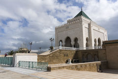 The Mausoleum of Mohammed V. A historical building located on the opposite side of the Hassan Tower on the Yacoub al-Mansour esplanade in Rabat, Morocco Stock Photos