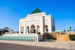 Mausoleum Mohammed V. The Mausoleum of Mohammed V is a historical building located on the opposite side of the Hassan Tower on the Yacoub al-Mansour esplanade in Royalty Free Stock Photo