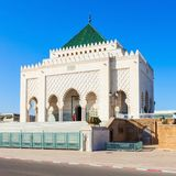 Mausoleum Mohammed V. The Mausoleum of Mohammed V is a historical building located on the opposite side of the Hassan Tower on the Yacoub al-Mansour esplanade in Stock Image